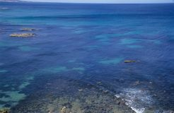 Beyond the coral reef. The open sea is amazing dark blue.It is in the Great Ocean Road,Australia Stock Photo