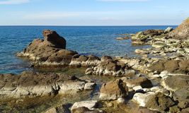 Beyond the cove 2. Rocks beyond the cove. Fodele. Crete. Greece Stock Images