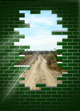 Beyond obstacles. A broken wall who discovered a new road Royalty Free Stock Photo