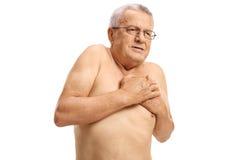 Bez koszuli dorośleć mężczyzna doświadcza klatka piersiowa ból Fotografia Stock