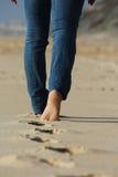 Bezahlt im Sand Stockfoto