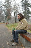 Bezdomny z różą fotografia stock