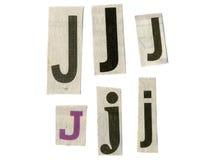 Bezeichnen Sie Schnitt vom Zeitungspapier mit Buchstaben stockbild