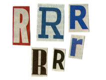 Bezeichnen Sie Schnitt vom Zeitungspapier mit Buchstaben lizenzfreies stockbild