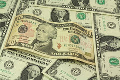 Bezeichnung zehn Dollar auf einem Hintergrund Lizenzfreie Stockfotos