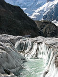 Bezengiyskaya glacier in the Caucasus. River at noon on Bezengi glacier in the Caucasus Royalty Free Stock Photography