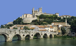 Beziers. St nazaire cathedral pont vieux (old bridge) river orb beziers herault langeuedoc roussillon south of france europe Royalty Free Stock Image