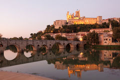 Beziers at dusk, France. Cathedral and Pont Vieux at night. Beziers, southern France Stock Image