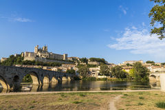 Beziers, France. Views at sunset of the French city of Beziers, with trees and the old bridge reflected over the river Orb, and the 13th-century Cathedral of Stock Photo
