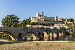Beziers, France. Views at sunset of the French city of Beziers, with trees and the old bridge reflected over the river Orb, and the 13th-century Cathedral of Stock Photos