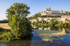 Beziers, France. Views at sunset of the French city of Beziers, with trees, the river Orb, and the 13th-century Cathedral of Saint Nazaire in the background Royalty Free Stock Photography