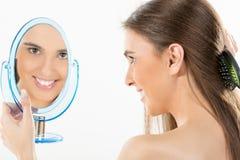 Bezinning in de spiegel Stock Foto's