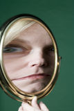 Bezinning in een spiegel Stock Foto