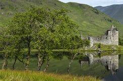 Bezinning van Kilchurn-Kasteel in Loch Ontzag, Hooglanden, Schotland Stock Foto