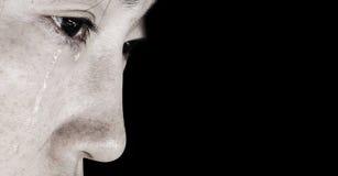Beznadziejna kobieta z łzą obraz stock