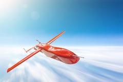 Bezpilotowy militarny truteń lata nad cloudscape słońcem jaskrawym, ruch plamy prędkość obrazy stock