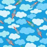 Bezszwowa ilustracja z rakietą i chmurami na błękitnym substracie Zdjęcia Royalty Free