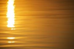 Bezszwowego tekstura ciepłego koloru olśniewający zmierzch wody powierzchnia Obraz Stock