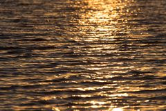 Bezszwowego tekstura Ciepłego koloru zmierzchu wody Olśniewająca powierzchnia Fotografia Royalty Free