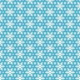 Bezszwowy błękita wzór z płatkami śniegu. Obraz Royalty Free