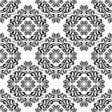 Bezszwowy czerń adamaszka wzór na białym tle. Zdjęcie Stock