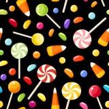Bezszwowy tło z Halloweenowymi cukierkami. Obrazy Royalty Free