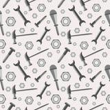 Bezszwowy wektoru wzór z narzędziami Chaotyczny baackground z śrubami, dokrętkami, młotami, wyrwaniami i śrubokrętami na popielat Zdjęcie Royalty Free
