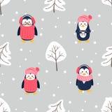 Bezszwowy wzór z śliczną kreskówka pingwinów sosną i śniegiem fotografia stock