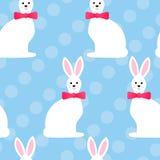 Bezszwowy wzór z ślicznymi Easter zabawy białymi królikami, okręgi, błękitny kolor również zwrócić corel ilustracji wektora royalty ilustracja