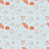 Bezszwowy wzór z czerwonymi parasolami na błękitnym tle Może używać dla tapety, deseniowe pełnie, tkanina, strona internetowa Zdjęcia Royalty Free