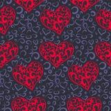 Bezszwowy wzór z jaskrawymi dekoracyjnymi sercami na ciemnym tle obraz stock