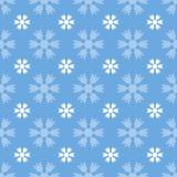 Bezszwowy wzór z płatkami śniegu na błękicie Obraz Royalty Free