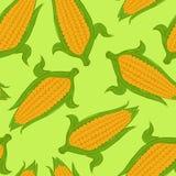 Bezszwowy wzór z słodką kukurudzą na zielonym tle royalty ilustracja