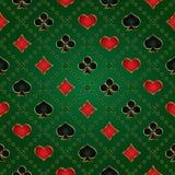 Bezszwowy zielony tło z karcianymi kostiumami Ilustracji