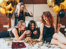 Bff hangout urban girls leisure lifestyle confetti. BFF hangout. Urban girls leisure and lifestyle. Glitter confetti and balloons decor. Young women in black royalty free stock photo