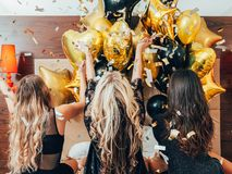 Bff hangout urban girls leisure lifestyle confetti. BFF hangout. Urban girls leisure and lifestyle. Glitter confetti and balloons decor. Young women in black stock images