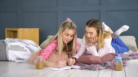 Bff leisure communication girlfriends chat. Friendship bff. fun leisure pastime. communication conversation. girlfriends laying on the floor chatting, writing in stock video