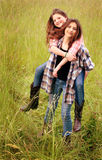 BFFs Piggyback Royalty Free Stock Images