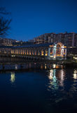 BFM Geneva night scene. Illuminated building of Batiment des Forces Motrices BFM on Rhone river in Geneva, Switzerland. Night scene Royalty Free Stock Photography