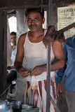 Bhadarsa, Uttar Pradesh / India - April 2, 2019: The local chai man poses for a photo during the morning rush. stock photo
