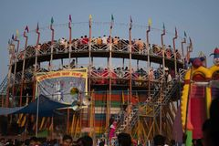 An outside shot of the wall of death at a festival surrounding NANDIGRAM BHARATKU royalty free stock photography