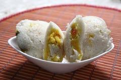 Bhagar Rice idli, Kodisama Rice idli, Jhangora Rice idli, Barnyard Millet Rice Cake, Kuthiraivali idli. Barnyard Millet is full of nutrients for the body needs stock photo