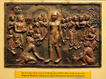 Bhagavan Mahaviras waling tour is beset with pleasant and painful distractions. Street bads relief on the wall of Jain Temple also called Parshwanath Temple in Royalty Free Stock Image