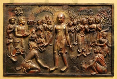 Bhagavan Mahaviras waling tour is beset with pleasant and painful distractions. Street bass relief on the wall of Jain Temple also called Parshwanath Temple in Royalty Free Stock Images