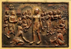 Bhagavan Mahaviras waling tour is beset with pleasant and painful distractions. Street bass relief on the wall of Jain Temple also called Parshwanath Temple in Stock Photo