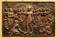 Bhagavan Mahaviras waling tour is beset with pleasant and painful distractions. Street bass relief on the wall of Jain Temple also called Parshwanath Temple in Royalty Free Stock Photo