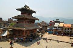 Bhairab Nath Temple, Bhaktapur, Nepal. BHAKTAPUR, NEPAL - APRIL 20, 2016: people around Bhairab Nath Temple in taumadhi Square from Nyatapola pagoda, Bhaktapur stock photo