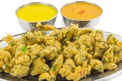 Pakora or Bhajiya. Bhajiya or Pakora is made with gram flour and spinach, This is the favorite street food of Indian and Pakistani people royalty free stock photos
