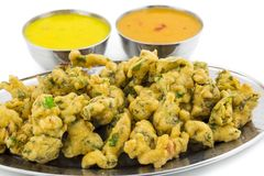 Pakora or Bhajiya. Bhajiya or Pakora is made with gram flour and spinach, This is the favorite street food of Indian and Pakistani people royalty free stock photography
