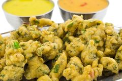 Pakora or Bhajiya. Bhajiya or Pakora is made with gram flour and spinach, This is the favorite street food of Indian and Pakistani people stock images